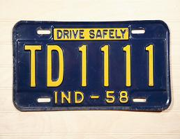 Antique Indiana license plate showing number 1111