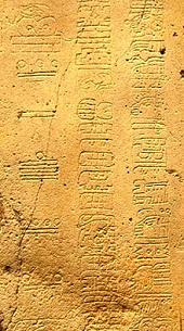 symbols of Long Count calendar date inscribed on maya artifact